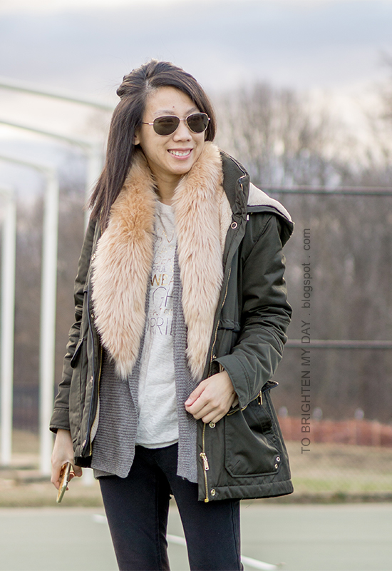 faux fur scarf, olive green parka, open cardigan sweater, graphic tee, black skinny jeans