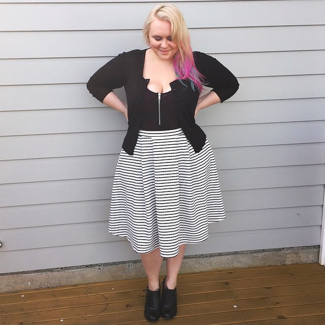 I call this my @sugercoatit look because it's an ankle boot & skirt combo! Wearing:  @yoursclothinguk textured stripe skirt, @citychiconline beaded cardigan, @boohooofficial zip bodysuit and @paylessshoesau ankle boots.