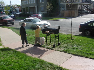 My protege works my grill while I grab another beer. | by Rob!