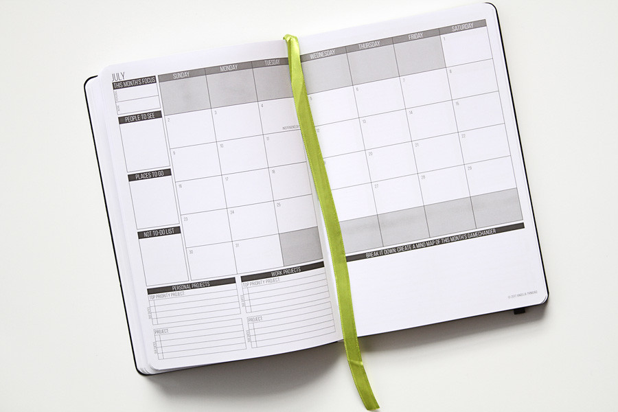 Calendar Planner For : Passion planner calendar notebook on a desk