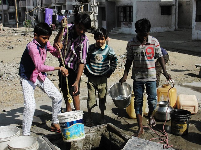 Children take water from the well at Bhuri Tekri. Drop out rate of the students in BSUP colonies has increased because schools are far away and the transportation is also not affordable.