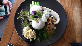 Potato leek rosti, asparagus, corn truffle hollandaise, poached vegan egg,almond fetta at Matcha Mylkbar