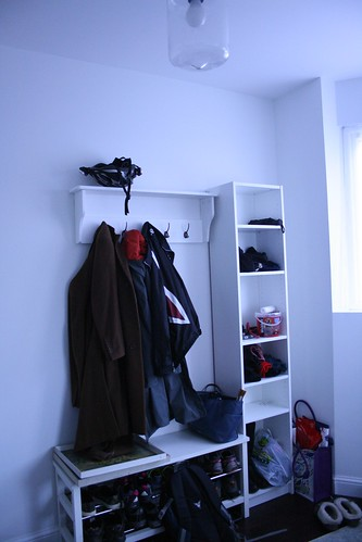 It's not perfect or gorgeous but it works perfectly for us. Our front entry has enough hooks for all our coats, places to put our sneaker/trainers and any winter items, as well as Barney's leads and collars. It works.
