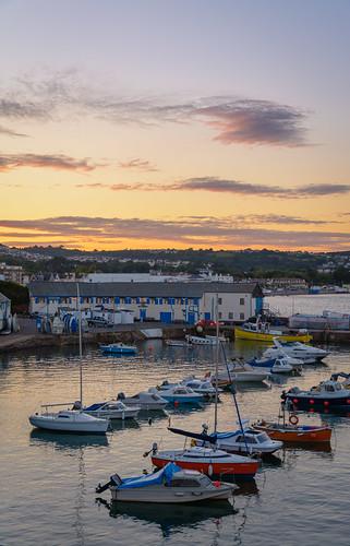 paignton harbour devon a warm glowing sunset over. Black Bedroom Furniture Sets. Home Design Ideas
