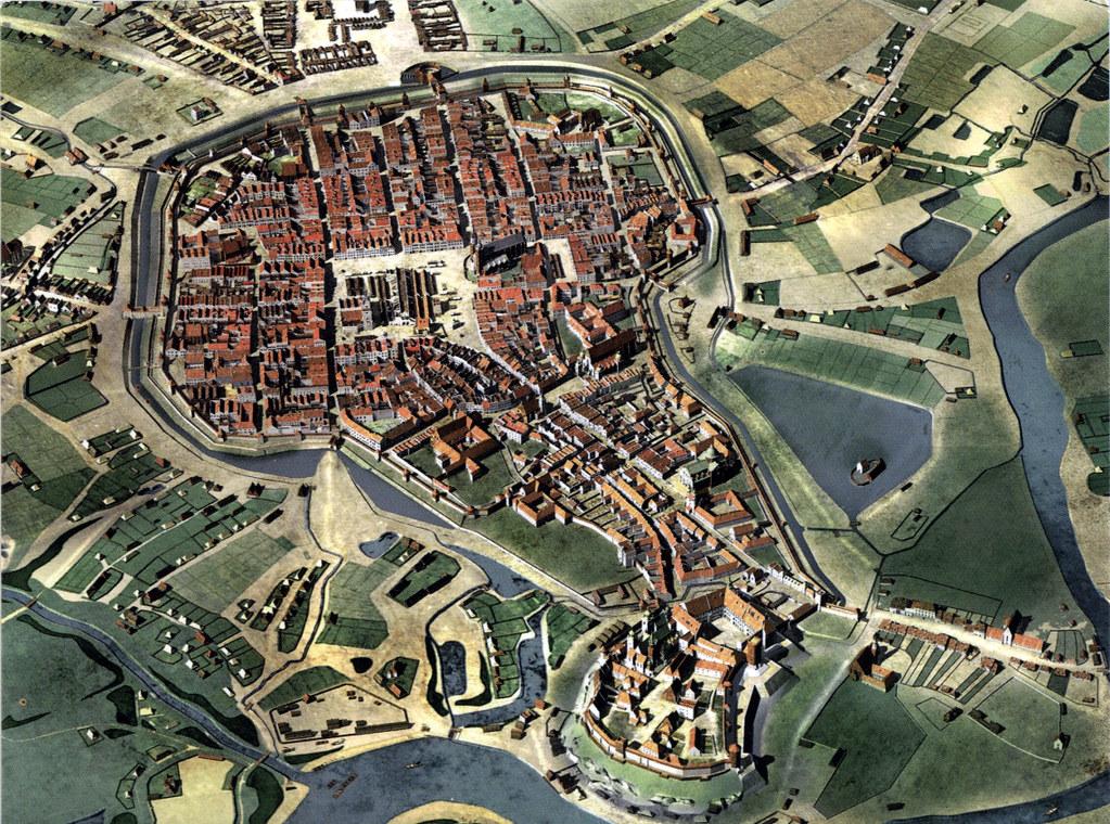 Vue de Cracovie au Moyen Age avec en bas de l'image le chateau de Wawel au milieu la place du marché (Rynek) et les fortifications tout autour.