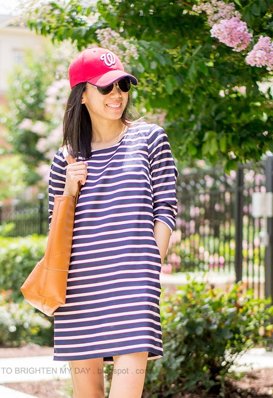 red cap, striped dress, cognac brown tote