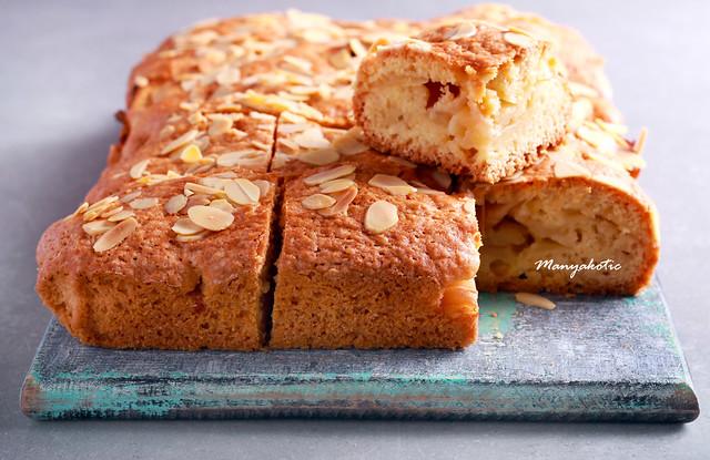 Devonshire apple cake, sliced on board