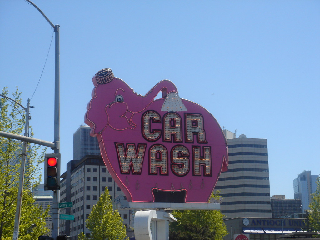 Neon Sign On Denny Way In