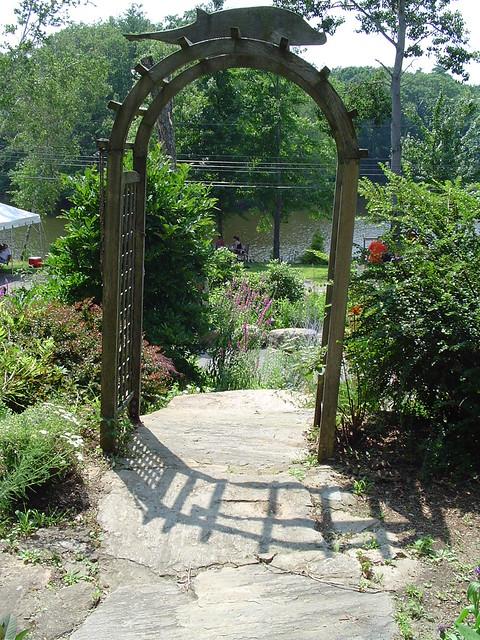 Garden gateway from inside the garden the wooden arch for Garden gateway