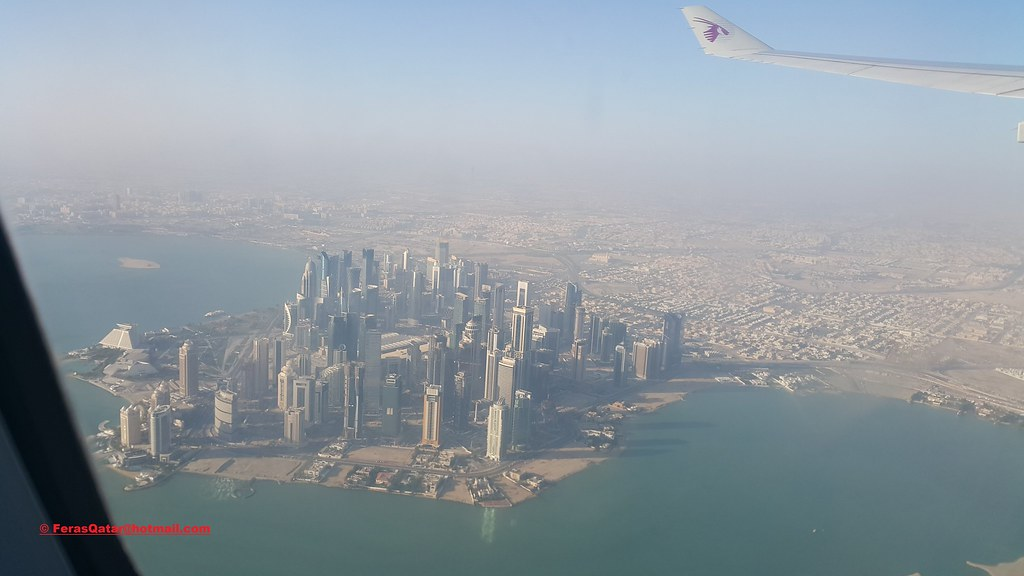 Doha City towers from Airplane after take off from Hamad I ...  Doha City tower...