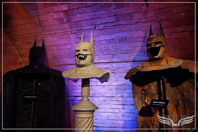 The Establishing Shot: BATMAN: ARKHAM KNIGHT CAPE & COWL EXHIBITION - L-R ACID RAIN BY LAUREN BAKER, BECOMING YOURSELF BUST BY THE CONNOR BROTHERS & THE CITY CORRODES US ALL BY MATT SMALL - KACHETTE, LONDON