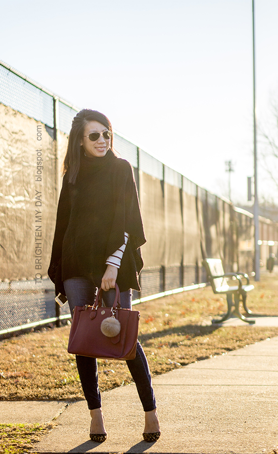 black knit poncho, burgundy striped turtleneck, burgundy tote with faux fur pom, leopard pumps