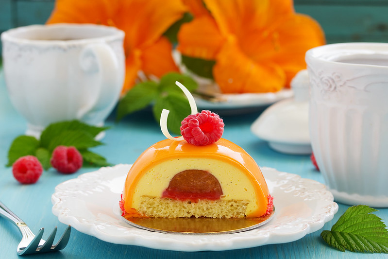 Delicious cake with vanilla mousse, peaches and raspberries