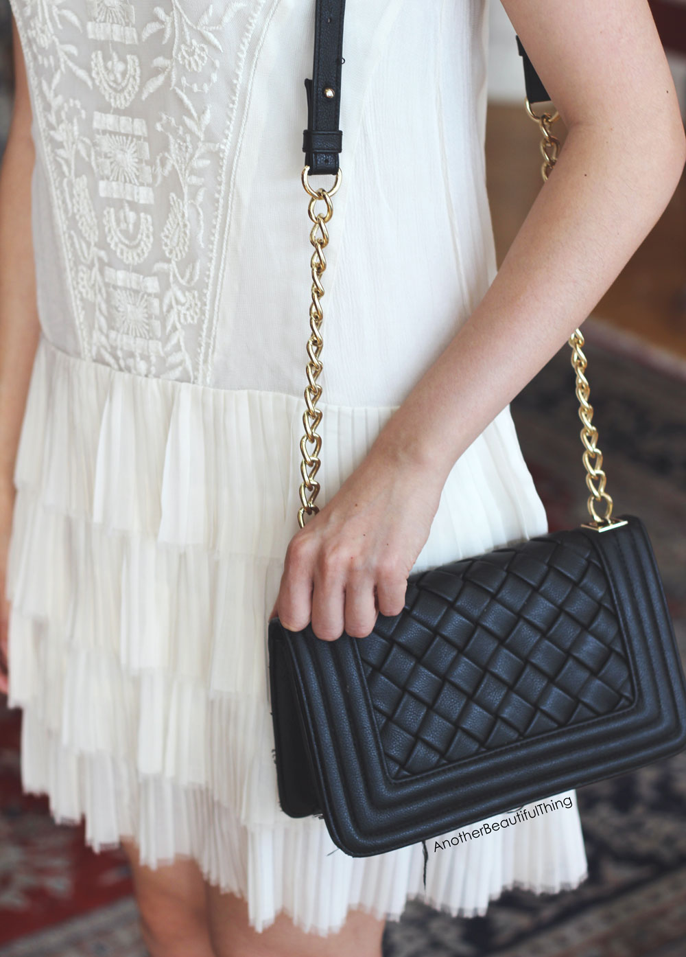 Flapper dropwaist white fringe dress and quilted black bag