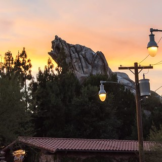 More of the great orange sky. Unfortunately there was no angle to get a shot with Grizzly Peak without the street lights. #disneyland #californiaadventure #radiatorsprings #grizzlypeak | by Campin' Guy
