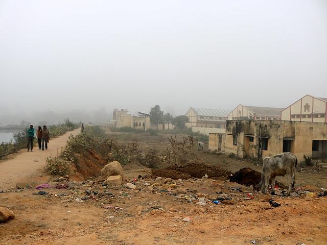 सीता सागर के बीच से निकला मार्ग व बने सरकारी भवन