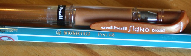 Bronze Uni-ball Signo in a broad tip and Turquoise Stabilo Pen 68/51