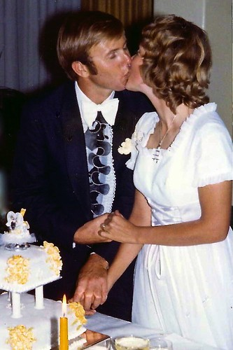 Paul and Jill Weaver kiss at wedding in 1973