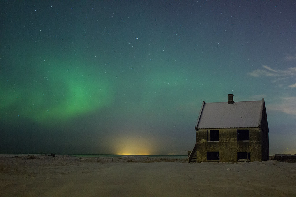Northern Lights over an abandoned house in Iceland