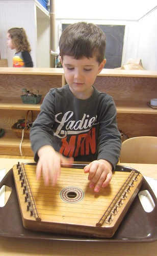 playing the lap harp