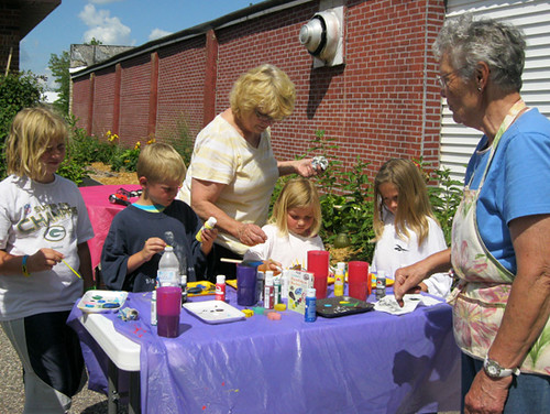 image: adults and children garden crafts