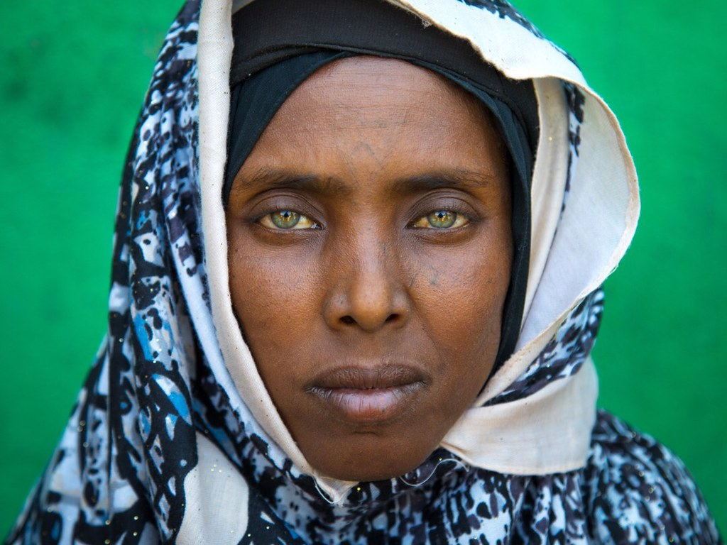 Portrait Of An Afar Tribe Woman With Green Eyes And Tattoo
