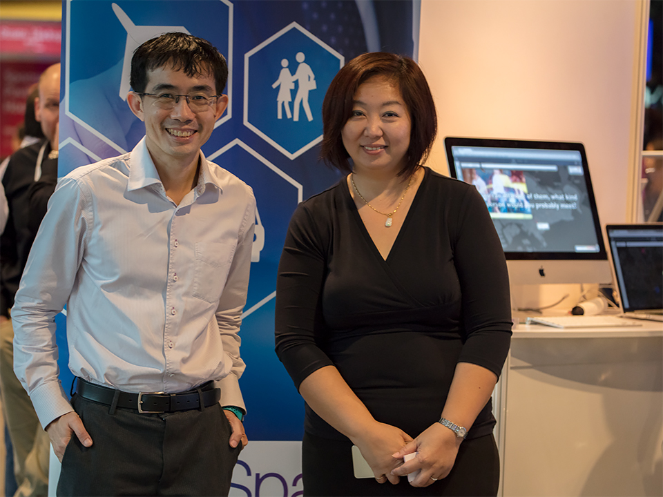 Addressing queries at DataSpark's booth, Strata & Hadoop 2016. (Left) Ying Shao Wei, COO, DataSpark; (right) Cathy Chang, Director of Delivery & Operations, DataSpark.