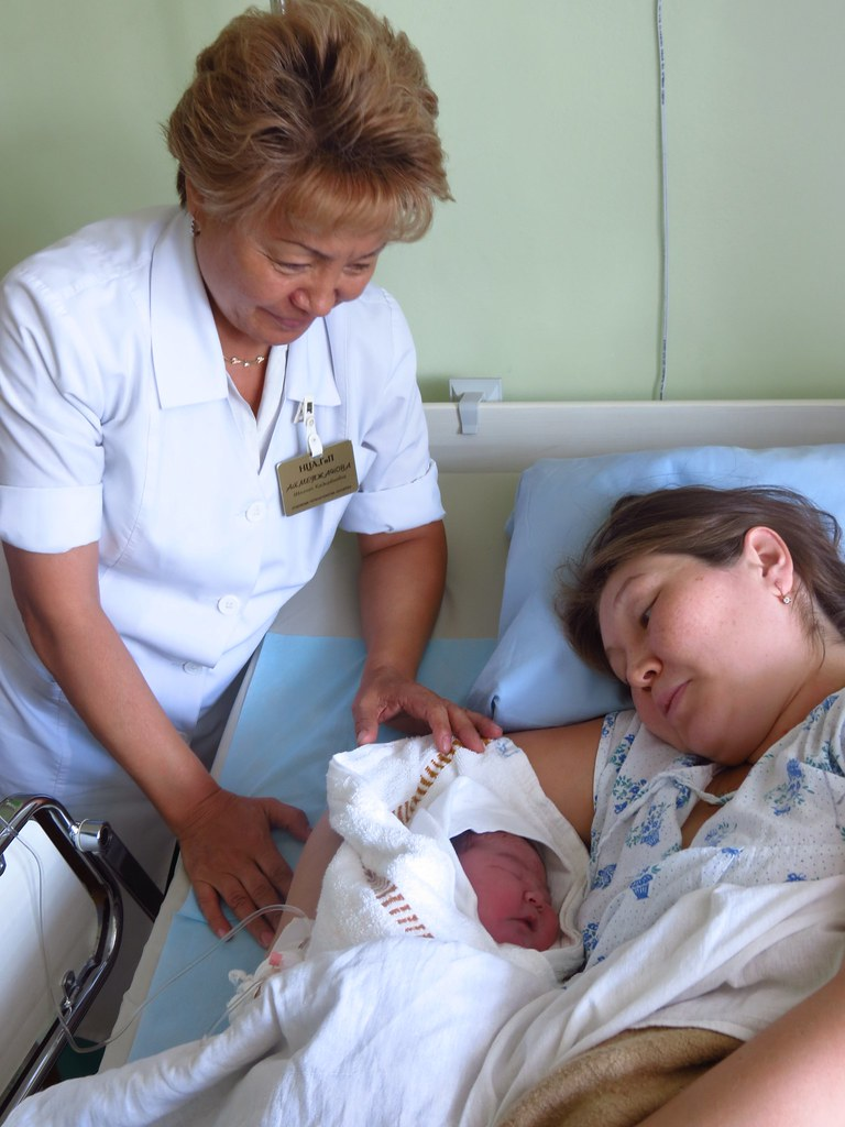 A Woman With Her Newborn Receiving Advice On The Importan Flickr