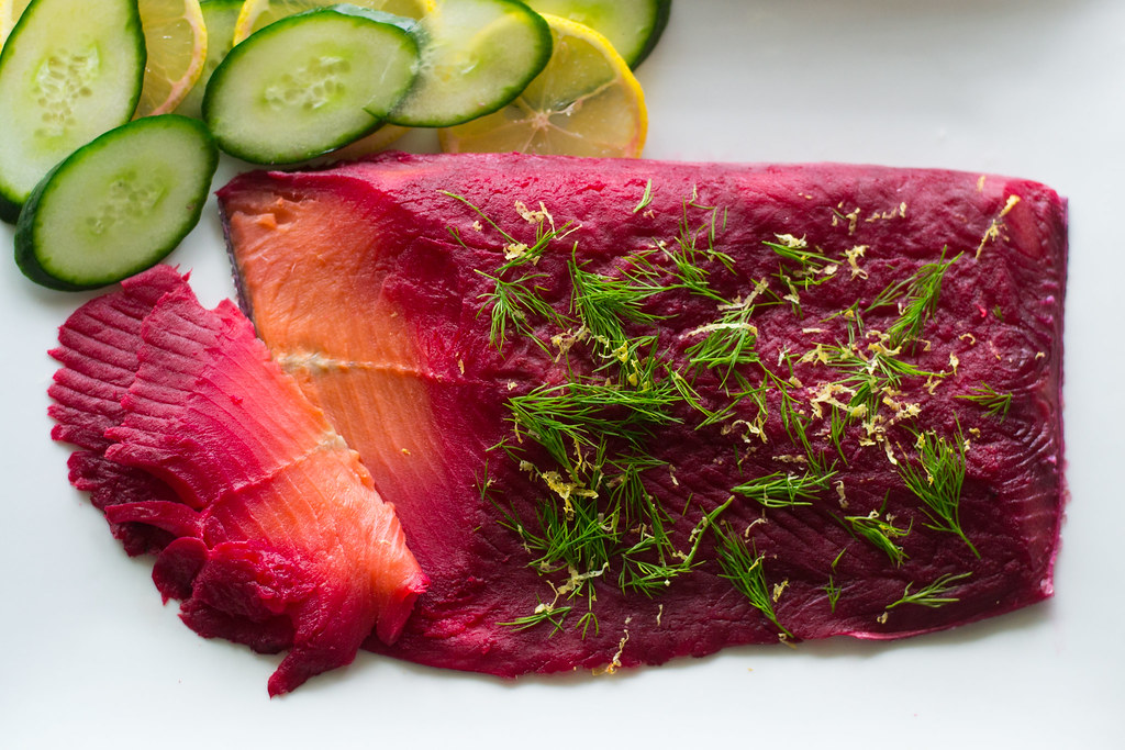 Homemade beet and dill cured lox with fresh lemon zest, salt and sugar.