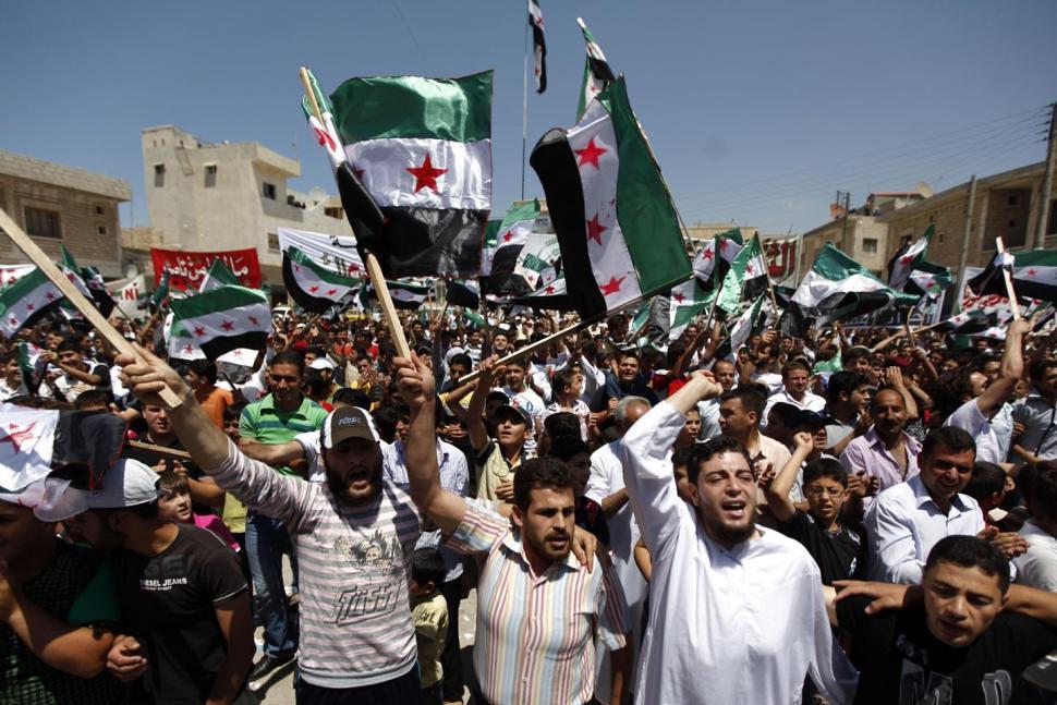 武裝駁火不斷發生使得阿薩德政權加強鎮壓,反過來又造成更遍地開花的反政府示威。(照片來源:AP)