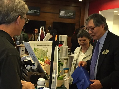 "USDA Director Janet Nuzum showing the USDA exhibit at ""Fast Forward 2060"" to Dr. Paul Watanabe"