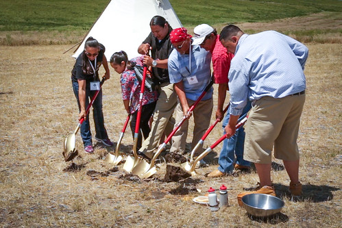 Representatives and family members of Thunder Valley Community Development Corporation break ground on the Thunder Valley project