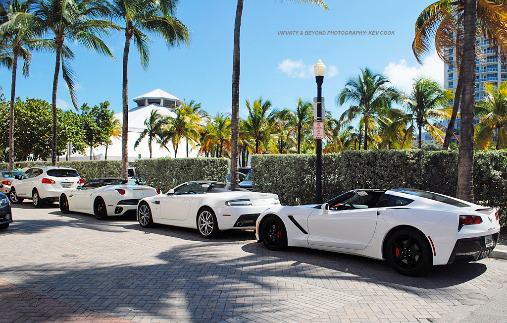 Four white exotic cars together miami beach just for Wing motors automobiles miami fl
