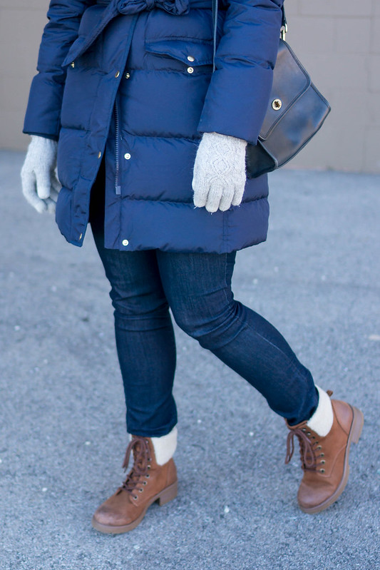 navy J.Crew puffer coat + tan hiking boots + navy stripe pom scarf + navy pom hat + Loft jeans; casual winter outfit | Style On Target