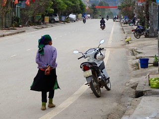 Traditional woman next to motorbike