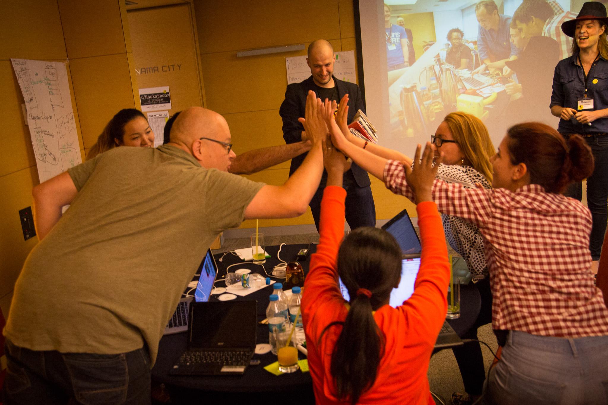 Hackathon participants celebrate a victory.(Photo: Hackastory)