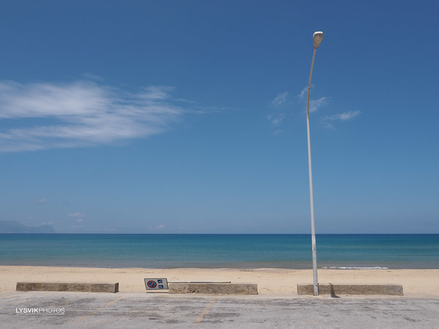 Car park with lamppost at beach