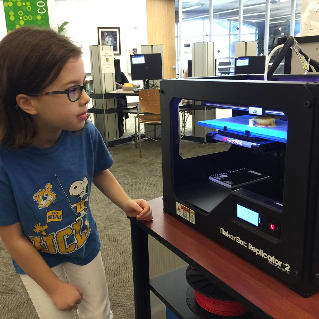 Child watching 3D Printer