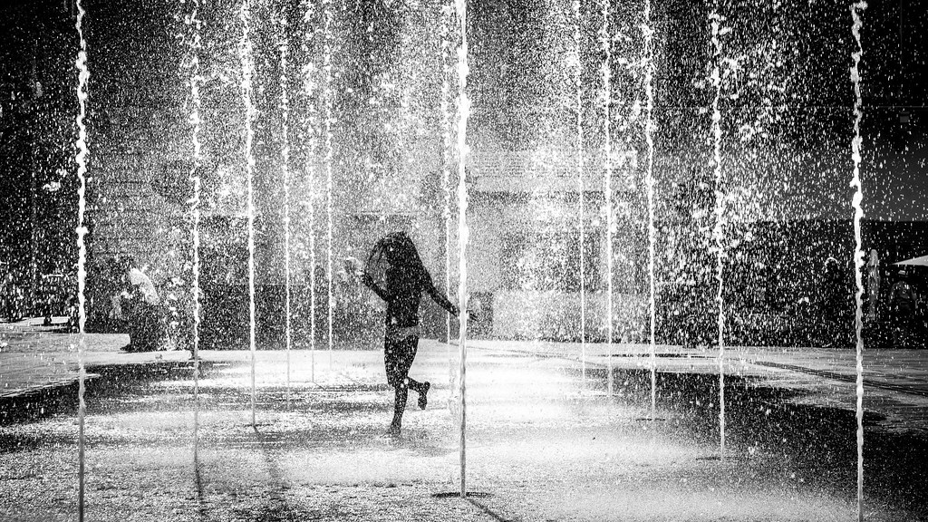 Dancing in the water valletta malta black and white street photography by