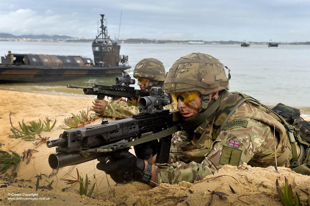 Pictured Are Two Royal Navy Marines Taking Part In A Simul