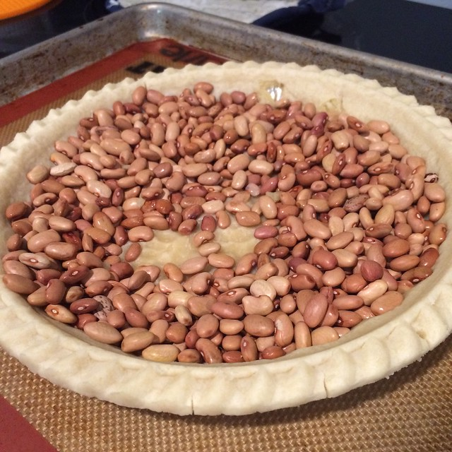 In which I attempt to blind-bake a pie crust with beans. And just beans. No parchment paper. Totally forgot it. To say I was distracted and stressed would be accurate. Of course, until I pulled this thing out of the oven, I'd convinced myself I was chill.