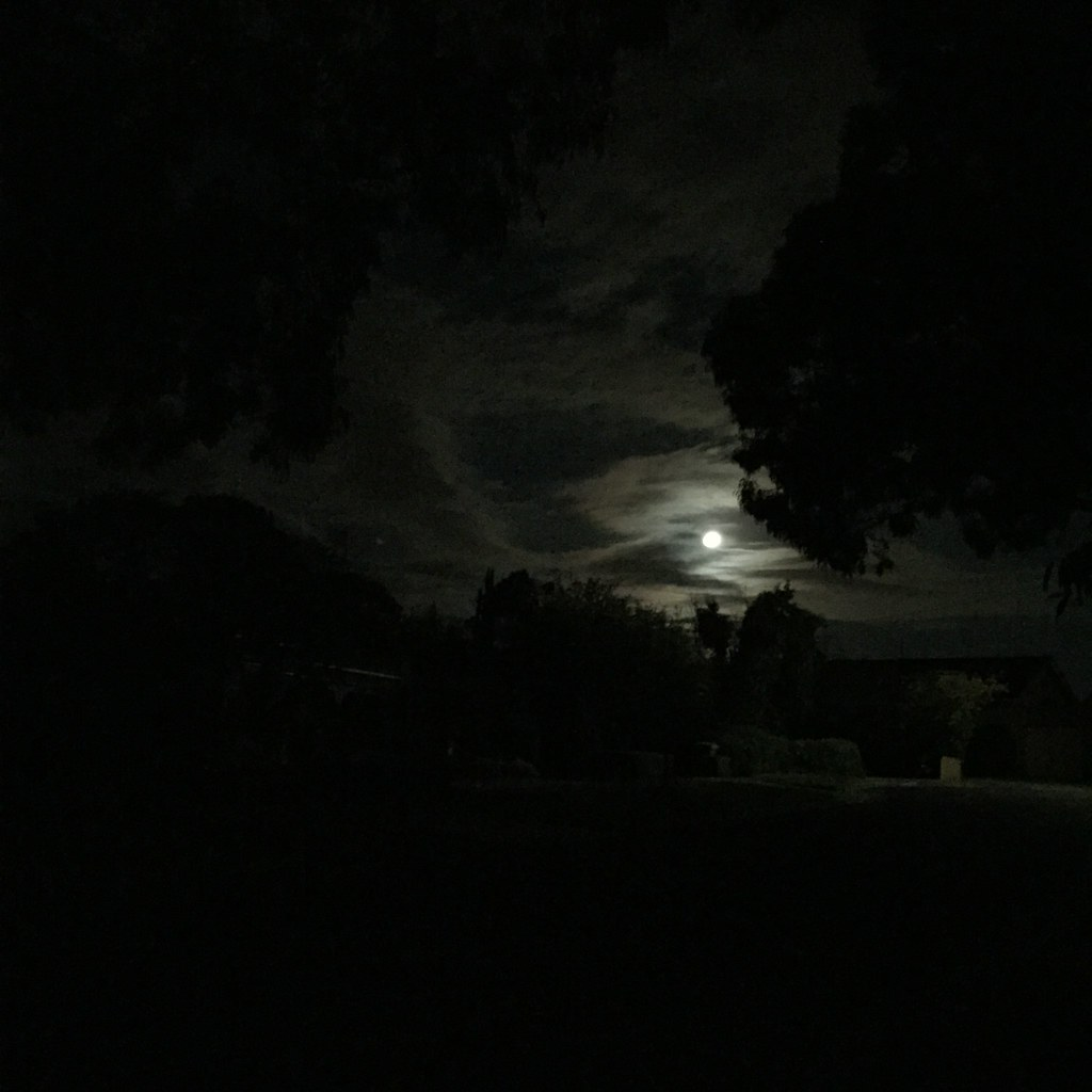 moody full moon with swathes of cloud on last night in september