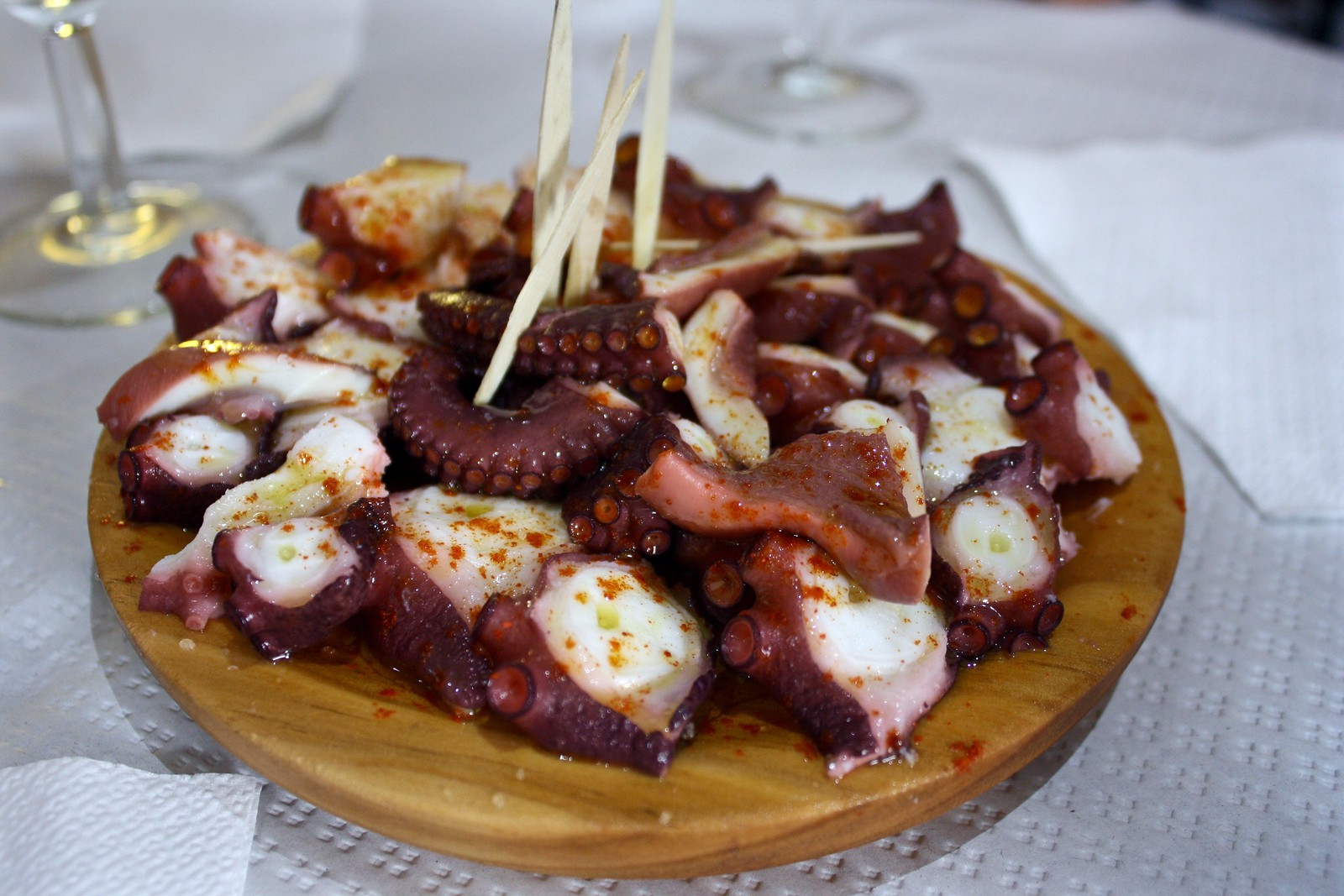 Boiled octopus on a wooden plate