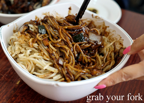 Mixing Jajangmyeon Korean Chinese black bean noodle at Yang Tz River in Eastwood