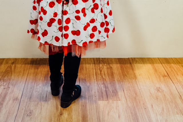 girl wearing dress with cherry print pattern