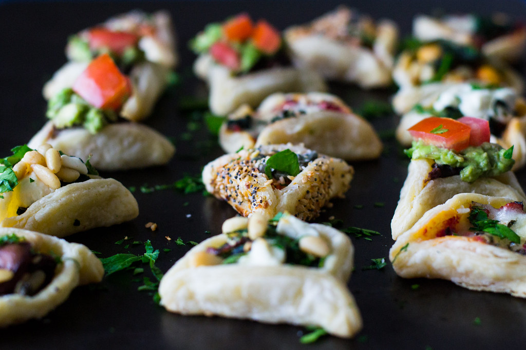 Savory hamantaaschen with six different 'around the world' fillings, including a pizza hamantaschen and so much more!