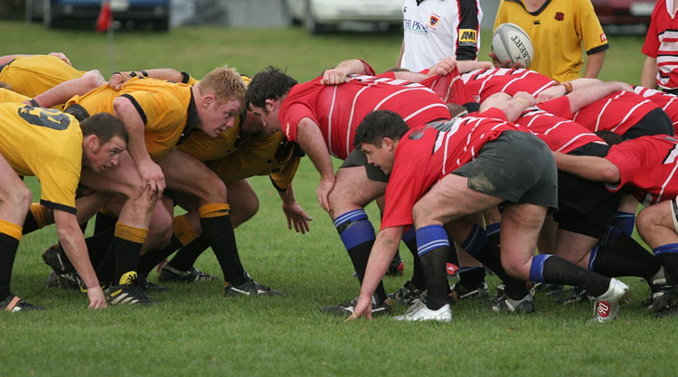 Two rugby teams prepare for a scrum