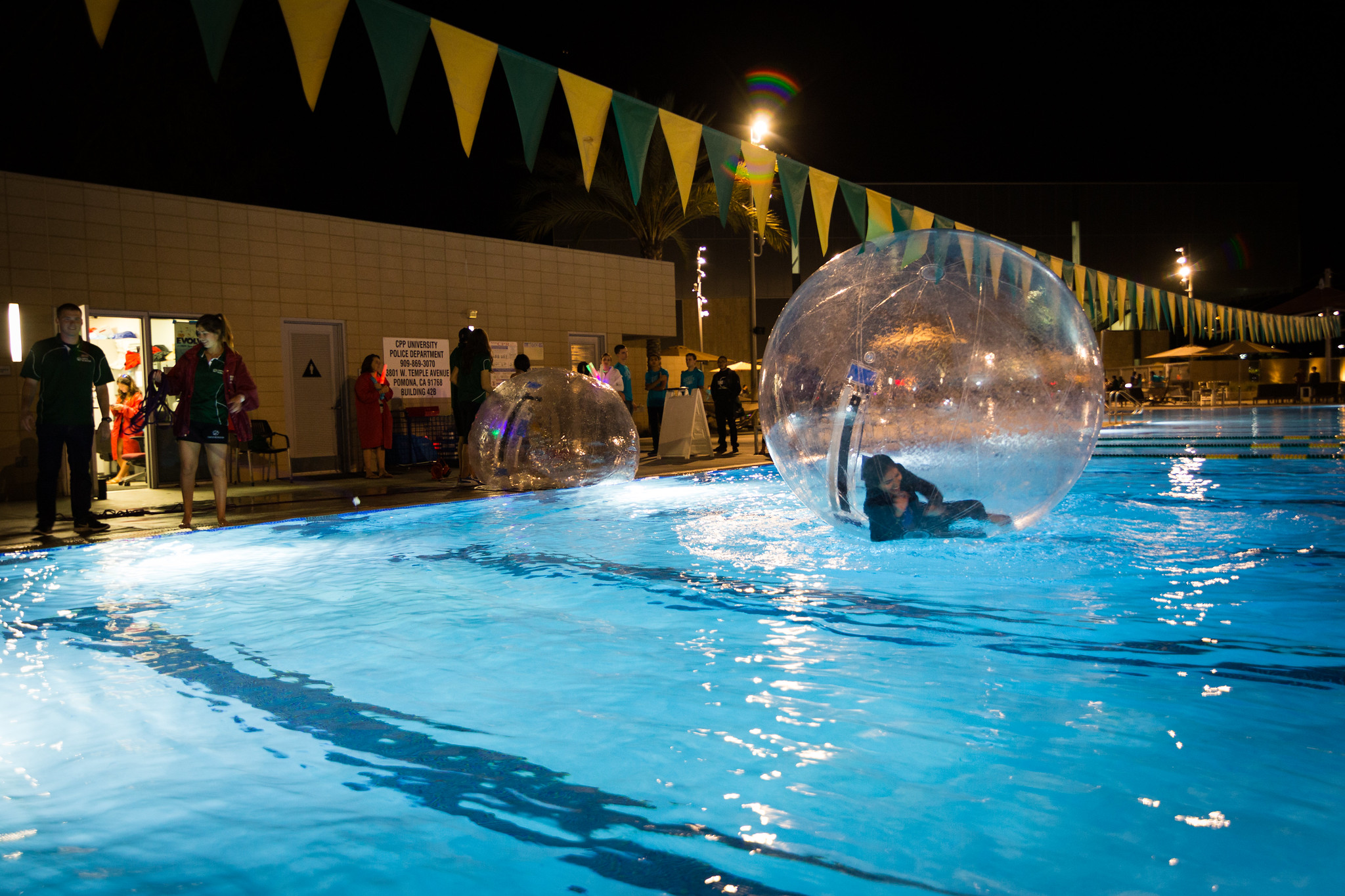 person falling in hamster ball in pool