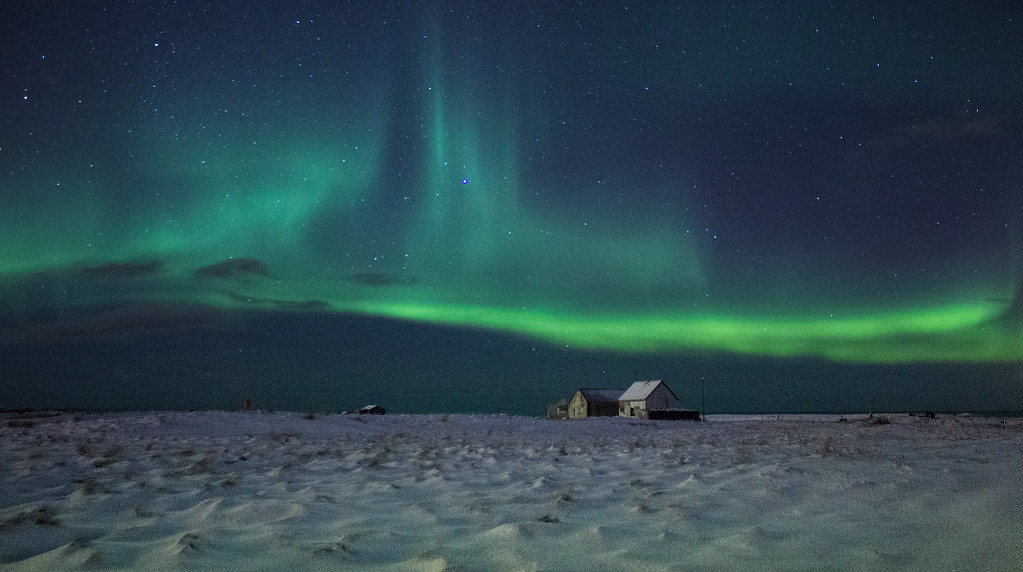 Northern lights over an Icelandic farmhouse