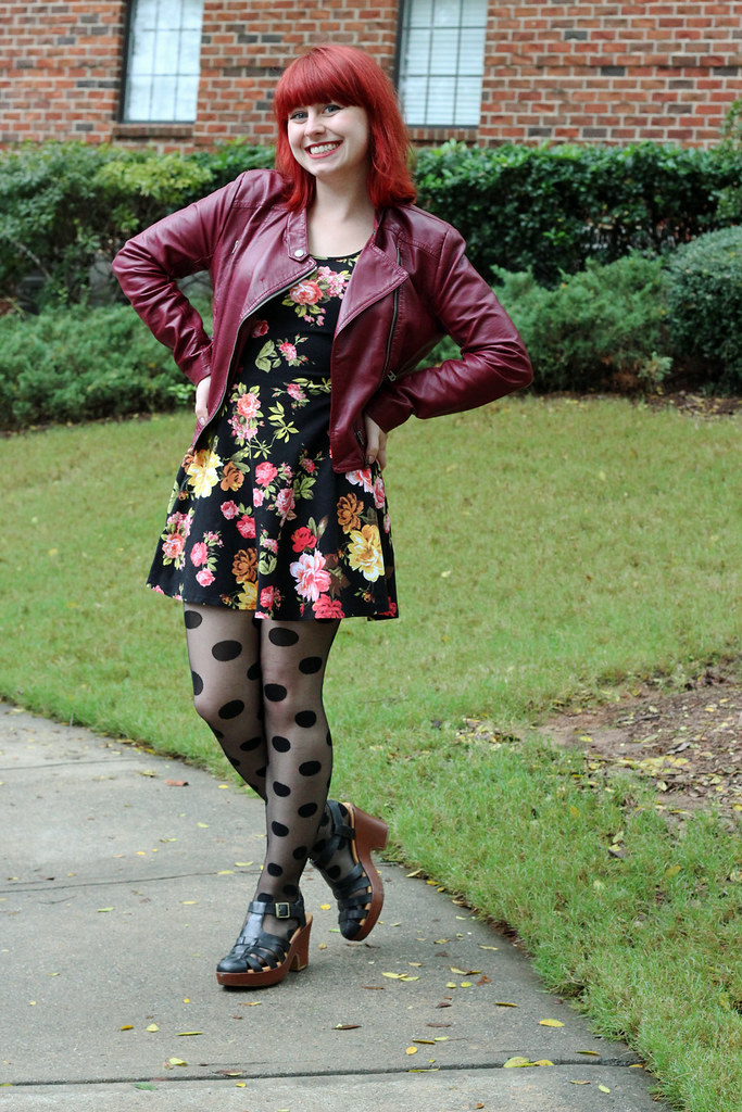 Dark Floral Print Dress, Polka Dot Tights, Chunky Black Heels, and a Burgundy Leather Jacket